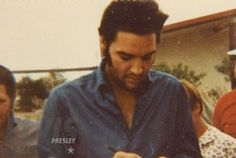 """Elvis signing autographs - candid on set for """"Charro!"""""""