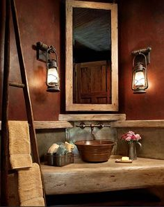 Love a ladder holding the towels, lantern as lights, the counter looking like wood and the sink sitting on not in the counter