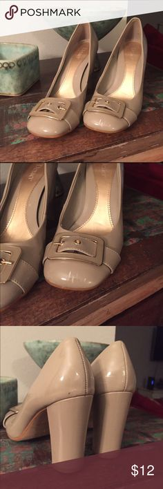 Nude chunky heels with buckles Nude heels that are super easy to walk in because of the chunky heel. Cute buckles over a squarish cut toe. Minor scuffs as shown in pics Dexter Shoes Heels