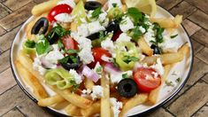 Get a head start on these loaded Greek fries by using frozen French fries for a quick and fresh weeknight meal. Greek Fries, Homemade Tzatziki Sauce, French Fries Recipe, Cast Iron Recipes, Stuffed Banana Peppers, Cast Iron Cooking, Greek Recipes, Vegetarian Recipes, Pizza Recipes