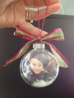 "Ornament using pictures of the kids and craft ""snow"" inside a glass ornament"