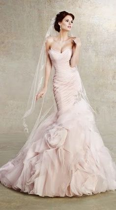 41b18463a0999 There is something spectacular about how Kitty Chen Couture wedding dresses  fit and flatter the curves of brides. Check out the sophisticated stunner  below…