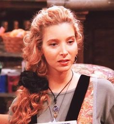 Phoebe Buffay's style is like a combination of the praise hands emoji and the upside down smiley.