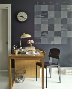 Chalkboard Wall Calendar - A home office is the ideal spot for a family planner. Six weeks' worth of squares in a variety of shades can accommodate several schedules. The entire wall is also coated with chalkboard paint for memos.