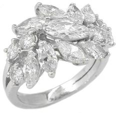 This is an amazing platinum ring from the 1960's. The ring is set with sparkling marquise and round cut diamonds that weigh approximately 2.75ct. The color of the diamonds is G with VS clarity.