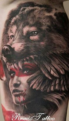 Girl with wolf head done by Remis Tattoo