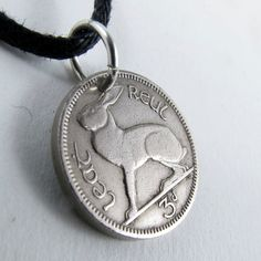 coin jewelry necklace. IRELAND. IRISH  rabbit Coin necklace irish bunny Celtic Music Harp Eire Hare. CHOOSE year No.00925. $9.95, via Etsy.