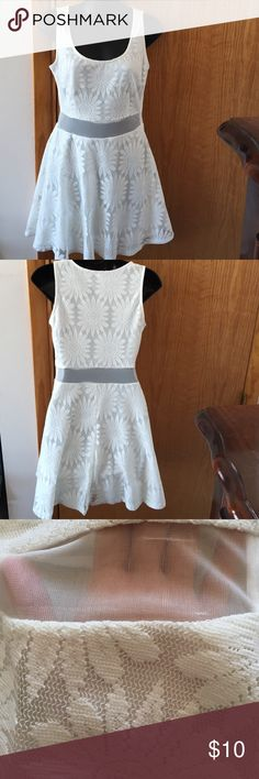 White dress White flower design dress, worn twice only flaw is the two tugs that are shown in the third picture Charlotte Russe Dresses Asymmetrical