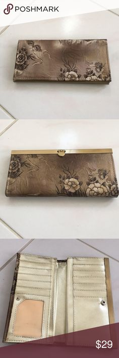 Wallet Beautiful Wallet. Brand New. Never Used. Gorgeous Exterior with Snap Closure. Dark Beige, Laced with Brown and Etched with Beautiful Flowers. Bloomingdale's Bags Wallets