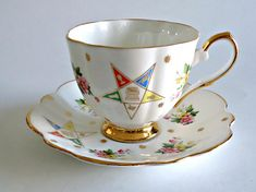 A lovely vintage teacup and saucer by Kent fine bone china with a Masonic symbol accentuated with a floral and gold star design. The teacup measures 3 high by 3 1/2 across the top, the saucer measures 5 1/2 in across. A lovely addition to your collection! If you have any questions