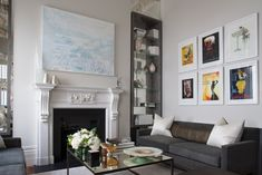 Hyde Park Apartments - living room filled with art posters, abstract paintings and dark grey sofas complimenting the light colour scheme 2 Bedroom Apartment, Apartment Interior, Apartment Living, Living Rooms, Luxury Interior Design, Interior Design Living Room, Interior Decorating, Big Wall Art, Photo Wall Art