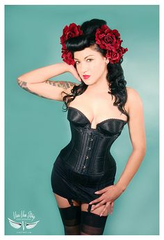 Corset, roses and garters with stockings. A lady is always properly dressed for all occasions.