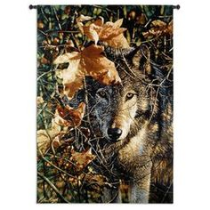 "Autumn Eyes Wolf Tapestry Wall Art by Bogie 37"" x 52""  features a wolf's steady, hungry gaze is captivating in this beautifully woven tapestry by artist Bogle"