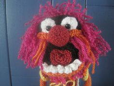 This Animal Muppet Inspired Amigurumi is approximately 14 inches tall, though gauge is not critical for this project. I have specific brands and colors of yarn I used listed in the pattern, but amigurumi is a great way to use up bits and pieces of your own stash! Message me with any questions, and Happy Hooking!