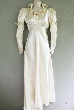 Wedding dress with Juliet sleeves, circa 1930-1940s.