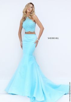 The hottest 2 piece of the season. Sherri Hill outdid herself with this taffeta mermaid skirt paired with a halter lace top. View Size Chart
