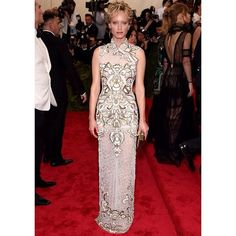 Amber Valletta wears a white, fine, handmade lace cheongsam by #albertaferretti with white velvet and burnished gold appliquè embroidery, complete with high slit details #MetGala2015 #metball #newyork #photooftheday