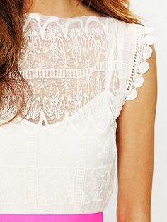 I love lacey/ delicate/ embroidered white tops...and the sleeves on this one are cute!