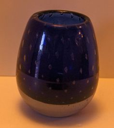 This Erickson Cobalt Controlled Bubble Vase measures approximately 7 inches high x 5 1/2 inches at its widest in the middle of the vase and 4 inches across the opening of the vase. It weighs 6 lb and 12 ounces. Very heavy cased glass at the bottom of the vase. It also still has an original Erickson paper label on the pontilled bottom Erickson Glass Cobalt Controlled Bubble Vase 3/10/15 update Free Standard Shipping in the U.S.