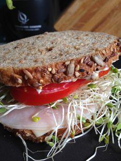 Good, clean sandwich! Honey turkey, vegennaise (bc I like the taste, not b/c Im vegan) tomato off the vine, alfalfa sprouts, spicy mustard on Dave's 60 calorie whole wheat / high fiber bread.  Photo by Mia Medeiros  #healthfood #sandwich #eatingsimple