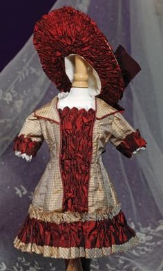 Lot: 261B: FANCY FRENCH BURGUNDY & TAN SILK BEBE DRESS & BON, Lot Number: 0261B, Starting Bid: $150, Auctioneer: Frasher's Doll Auction, Auction: FROM THE STORE BEFORE-FANCY DOLLS & DRY GOODS, Date: October 20th, 2012 EDT