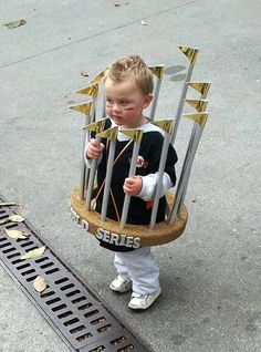 10/31/12. ADORABLE! This young SF Giants fan is dressed up as a World Series Trophy!