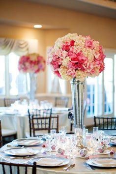 CENTERPIECES - TALL :: This is a good example of the tall arrangement - We will be making a mix of hot pink, light pink and ivory. Ivory hydrangea, white snapdragons, hot pink roses, pink hyacinth and white stock with hot pink godetia.