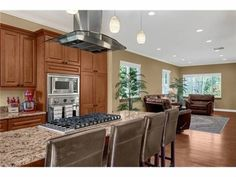 pretty kitchen....like the use of the rug to divide the open living room and kitchen space