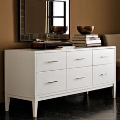 A leg up. The Narrow-Leg Dresser shows off gracefully tapered legs and sleek metal handles. Not content to get by on looks alone, it offers six sizeable drawers to meet your bedroom storage and organizational needs.