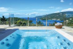 Villa Christina in Sivota, Epirus.  Christina is a beautifully designed villa with elegant, contemporary styling, perched on the hillside enjoying breath-taking views across the Ionian Sea and picturesque coastline.