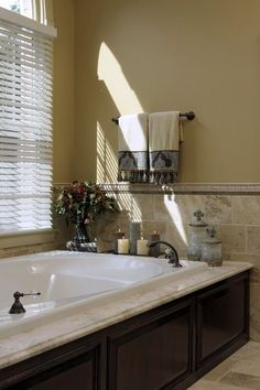 Dark cabinets/light granite love the added wood around the bath