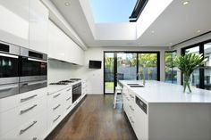 Kitchen with light court in ceiling - Hamer Architects