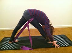 Roni Brissette in Pyramid pose using a traction belt
