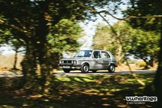 Silver Golf Mk1 GL driving in forest