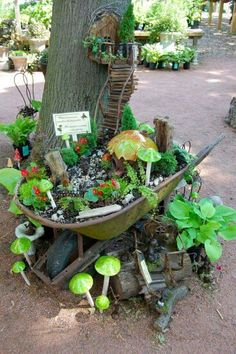 Great way to re-use an old wheel barrow and create a fairy garden.