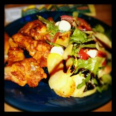 Hot wings, accompanied by a potato salad dressed in balsamic vinegar..