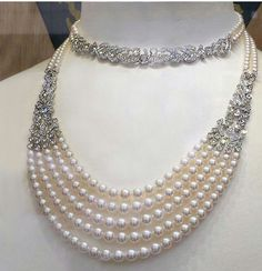 I'd love to wear a stunning diamond and pearl necklace like this one with my wedding dress, it's beautiful!