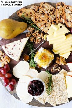 This is a Thanksgiving Snack Board to put an end to both the complaints and the hunger pains while you and your crew are waiting on the turkey to finish cooking. It's ready in less than 20 minutes. For this foolproof, easy Thanksgiving appetizer, just pick your three favorite cheeses, jam, fresh or dried fruits, sweet nibbles, and a medley of nuts and crackers.