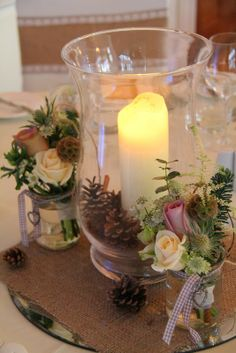 """Hurricane lamps surrounded by the """"Pew End Posies"""" looked magical"""