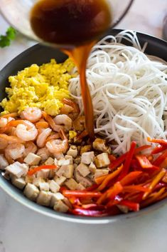 A skillet with the ingredients for Pad Thai including rice noodles, shrimp, scrambles eggs, bell pepper and pad thai sauce being poured on top. Pad Thai Sauce, Thai Recipes, Asian Recipes, Cooking Recipes, Thai Cooking, Asian Cooking, Stir Fry Dishes, Thai Dishes, Shellfish Recipes