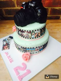 18th birthday cake with edible camera and modelling chocolate roses  www.facebook.com/caggyscakes