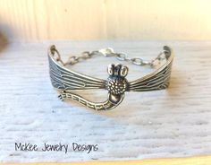 Sterling Silver (plated) metal dragonfly cuff, with chain and small charm. Vintage inspired dragonfly bracelet. McKee Jewelry Designs