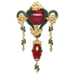 A large Victorian garnet, diamond and green enamel brooch
