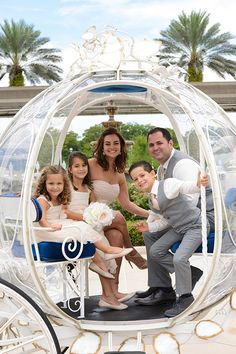 This adorable family takes a ride in Cinderella's Coach after a vow renewal at Walt Disney World