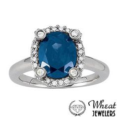 Oval Halo Sapphire Engagement Ring with Plain Band and Diamond Prongs available at Wheat Jewelers