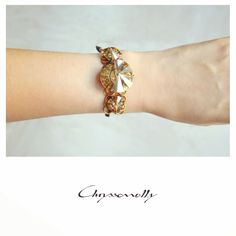 JEWELRY | Chryssomally || Art & Fashion Designer - A striking bracelet with gold Swarovski crystals, gold steel chain and black silk cord