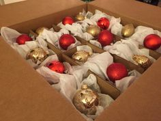 Christmas storage hack! Place ornaments of all sizes in a moving box to keep fragile decor protected all year long.