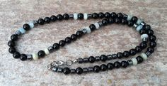 Check out this item in my Etsy shop https://www.etsy.com/listing/238040996/mens-beaded-healing-stones-necklace-in