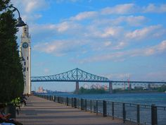 Clock tower and La Ronde and Jacques-Cartier Bridge Jacques Cartier, Old Port, Of Montreal, Canada Travel, Great Places, Bridge, Places To Visit, Photos, Tower