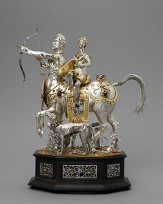 This outstanding example of Augsburg gold work around 1600 combines the function of a clock with that of a table automaton, ca. 1602.  Sagittarius?